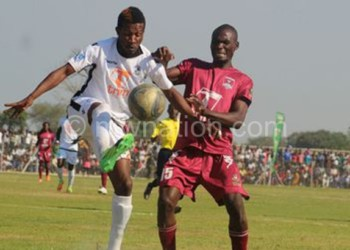 A Super League match in action at one of the venues Karonga Stadium