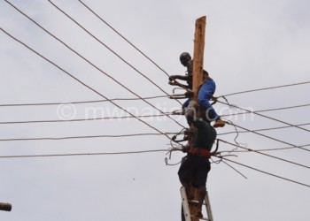 Escom workers fixing transmission lines