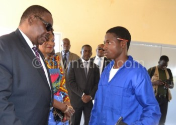 President Peter Mutharika (L) believes technical skills  empower the youth