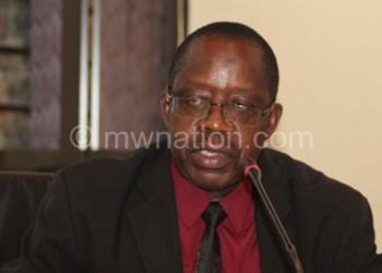 Flashback: Shaba (L) cuts a ribbon to mark listing of NFB corporate bond as MSE chief executive officer John Kamanga looks on