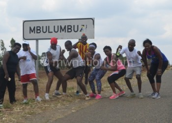 The runners pose for a picture at Mbulumbuzi in Chiradzulu
