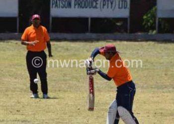 Cricket action between Orange and Lankans