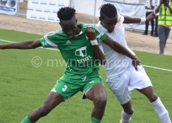 Bullets' Dalitso Sailesi (R) battles for the ball with a Nchalo player