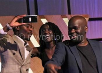 Selfie time: Daliso (R), Coltida(C) and Namadingo pose for a selfie