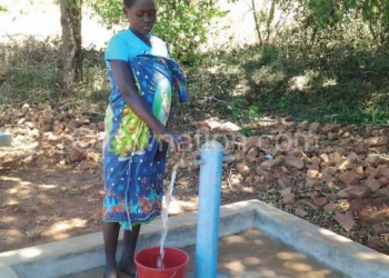 Mphande draws water from the new tap