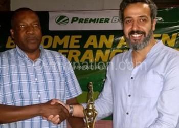 Younes (R) presents trophy to Katsala