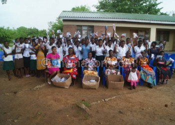 Students from schools within TA Kachindamoto's area celebrate after receiving free reusable sanitary pads