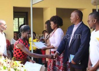 Malisita (R) gives a certificate Mangulama