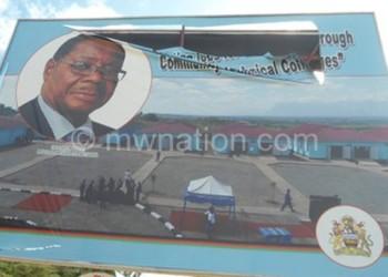 A billboard bearing Mutharika's portrait was vandalised in Karonga