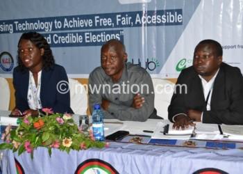 Sibande (L), Mwalubunju (C) and Kalindakafe (R) briefing stakeholders on the situation room