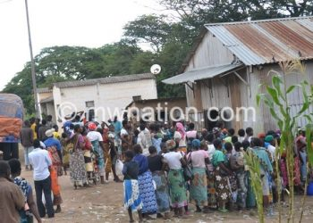 People queue to buy maize at Admarc market