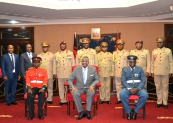 Mutharika poses with Salimu (seated L), Nkhoma (seated R) and MDF senior officers