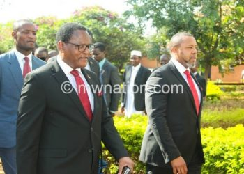 Chakwera (L) and Chilima leave after following one of the court proceedngs