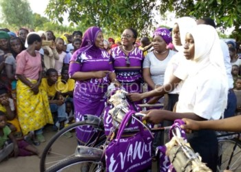 Some beneficiaries with bicycles as Mambo (L) and Mihowa (2ndL) look on