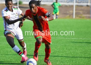 Tabitha Chawinga (R) in action against Kenya in the Olympic qualifiers