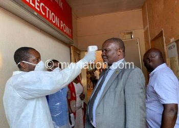 Dausi gets a Covid-19 screening in this file photo