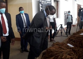 Kasaila appriciates tobacco quality during the official opening of the market