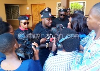 Mtambo (C) addresses the media
