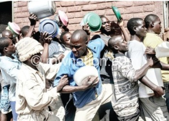 Prisoners fight for food in this file photo