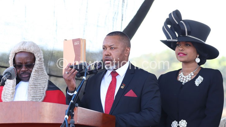 Chakwera takes oath of office assisted by Judiciary registrar Agnes Patemba R as First Lady Monica smiles   The Nation Online