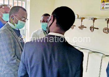 Mndolo (L) takes the minister through the oxygen plant