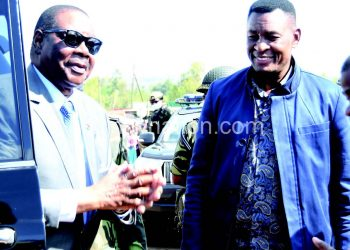 Chisale (R) with Mutharika in this file photograph