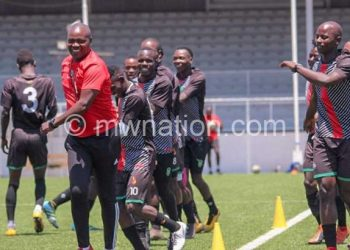 Mwase (in red) trains with players before suspension