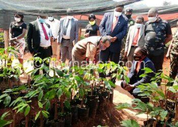 Singh explains planting methodology as Kandodo, his deputy  Verah Kamtukule and others listen