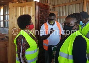 Tembo (L), ministry's PS Yanila Ntupanyama (R) admire doors produced at the firm