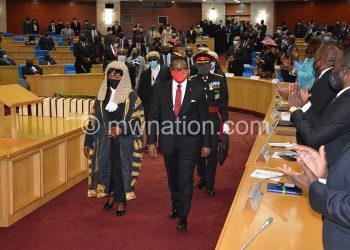 Chakwera (middle) arrives in the House to deliver Sona