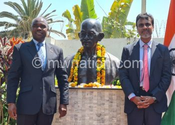 Mkaka (L) poses with Bhushan after unveiling the bustduring