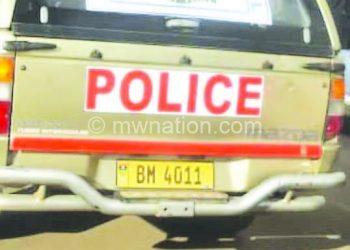 A civilian vehicle bearing police symbols in Limbe