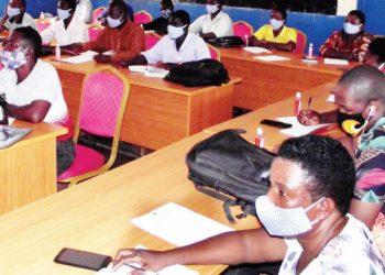Participants listen to a presentation | The Nation Online
