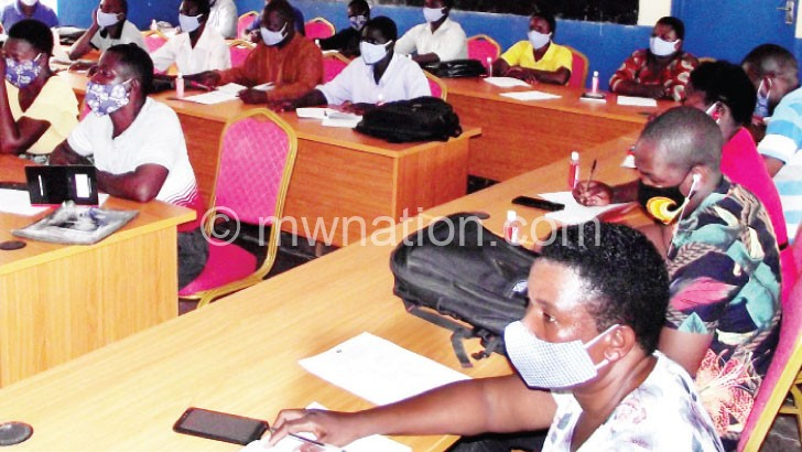 Participants listen to a presentation | The Nation Online