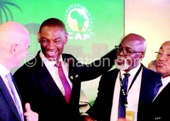 Ahmad (R) with Nyamilandu (2ndL), Fifa president Gianni Infantino (L) and Nigeria FA president Amaju Pinnick in this file photo
