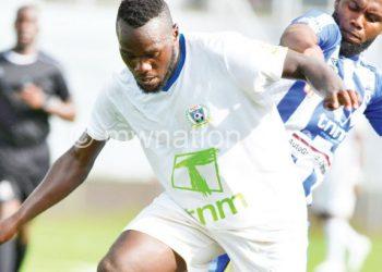 Manyozo tries to stop Karonga's two-goal hero Sheriff Shamama
