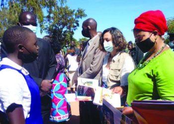 Kaliati (in red headgear and Torres inspect schoolgirls' work