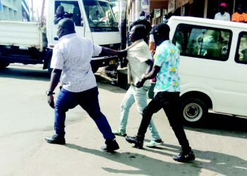 Plain-clothed police officers enforcing mask wearing in Blantyre