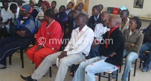 Chikondi Banda (R) and colleagues listen to a presentation by Teveta
