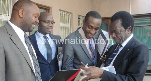 Lawyers for the Bingu estate and Estate Duty Commissioner sharing notes after an earlier court appearance